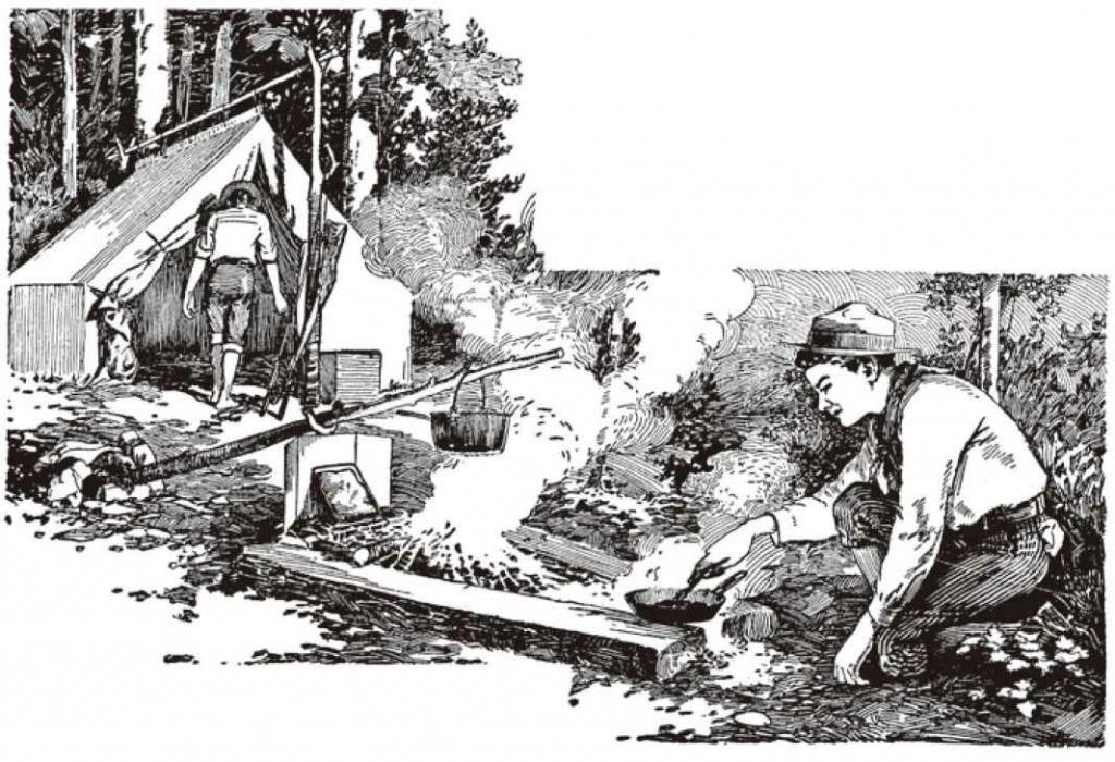 摆放成V形的两根青原木形成烹饪区域,在宽的一端放几块石头,石头上放硬木生火。